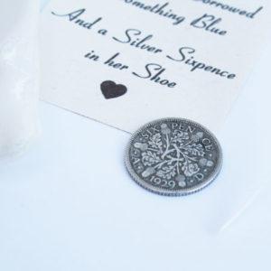 and a silver sixpence in her shoe