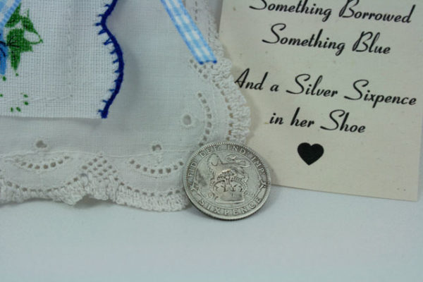 And a silver sixpence in her shoe..