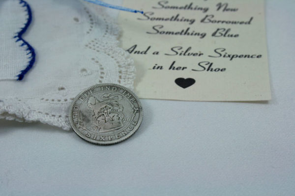 and a silver sixpence in your shoe