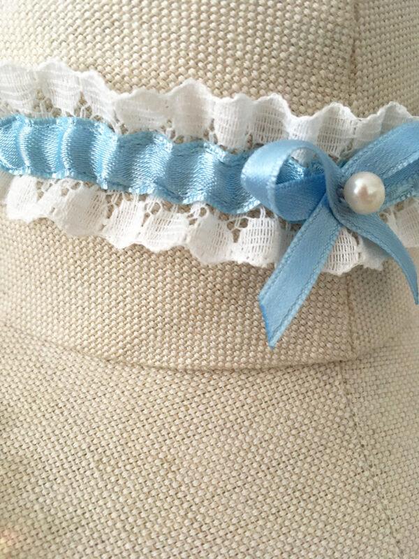 Kousenband met blauw strikje en zoetwaterparel