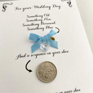 kaartje met something blue, Swarovski kristal en een sixpence
