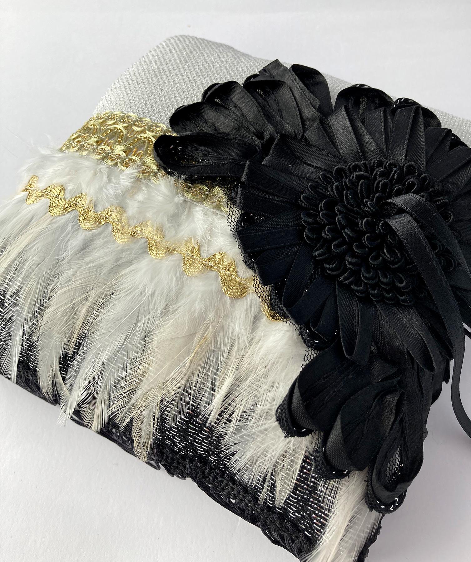extravagant ringkussen in zwart, wit, goud en zilver
